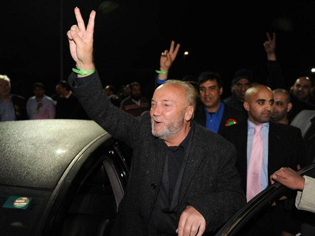 George Galloway of the Respect Party celebrates with his supporters after winning the Bradford West by-election at the Richard Dunn Sports Centre