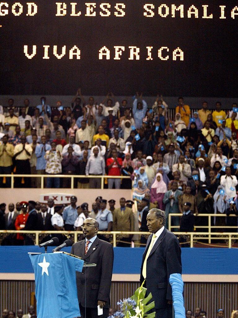 Yusuf, right, is sworn in as president of Somalia in 2004