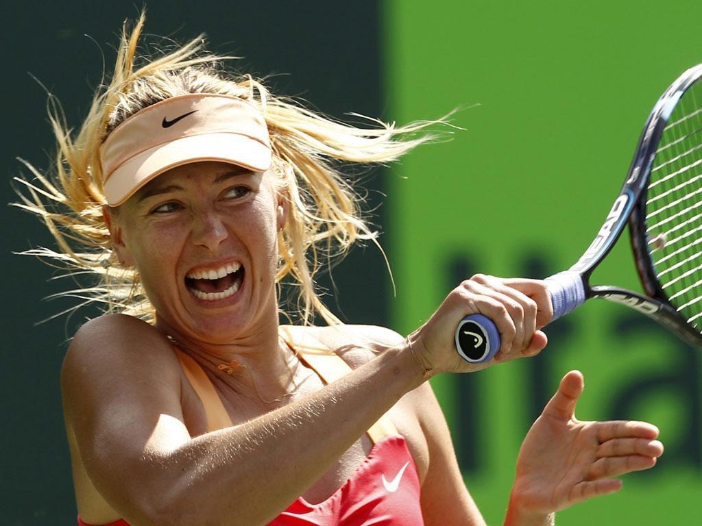 Maria Sharapova plays a forehand during her win over Caroline Wozniacki