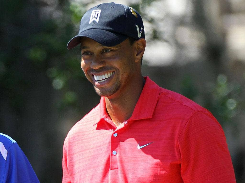 Winning smile: Woods reclaims his old position as Augusta favourite