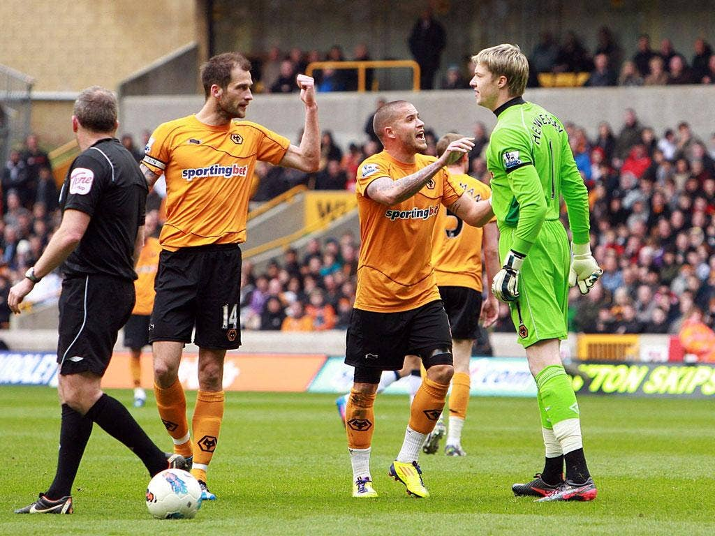 Baying Wolves: Roger Johnson (left) confronts his own goalkeeper Wayne Hennessey as the tension mounts at Molineux