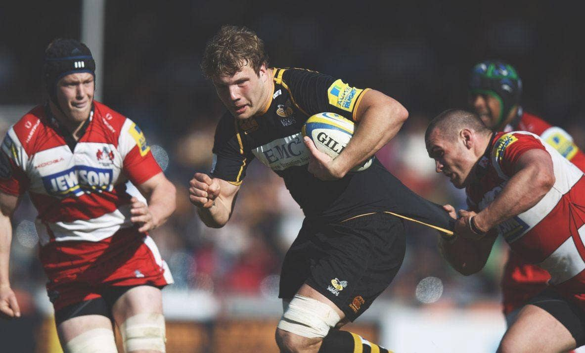 Gloucester's Dan Murphy gets to grips with Joe Launchbury, of Wasps, during a thriller at Adams Park yesterday