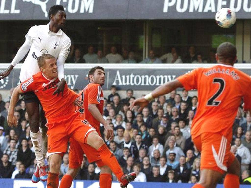 Emmanuel Adebayor nods in the second of his two goals during the 3-1 victory over Swansea