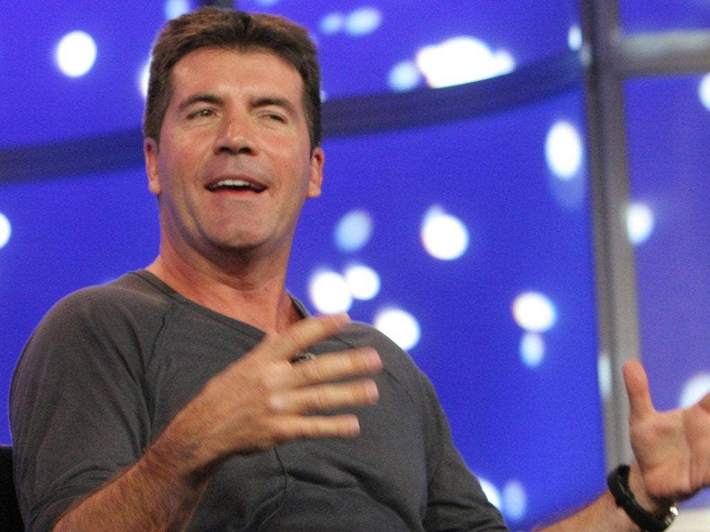 SIMON COWELL: The producer has challenged songwriters to pen hit songs for the band's next album