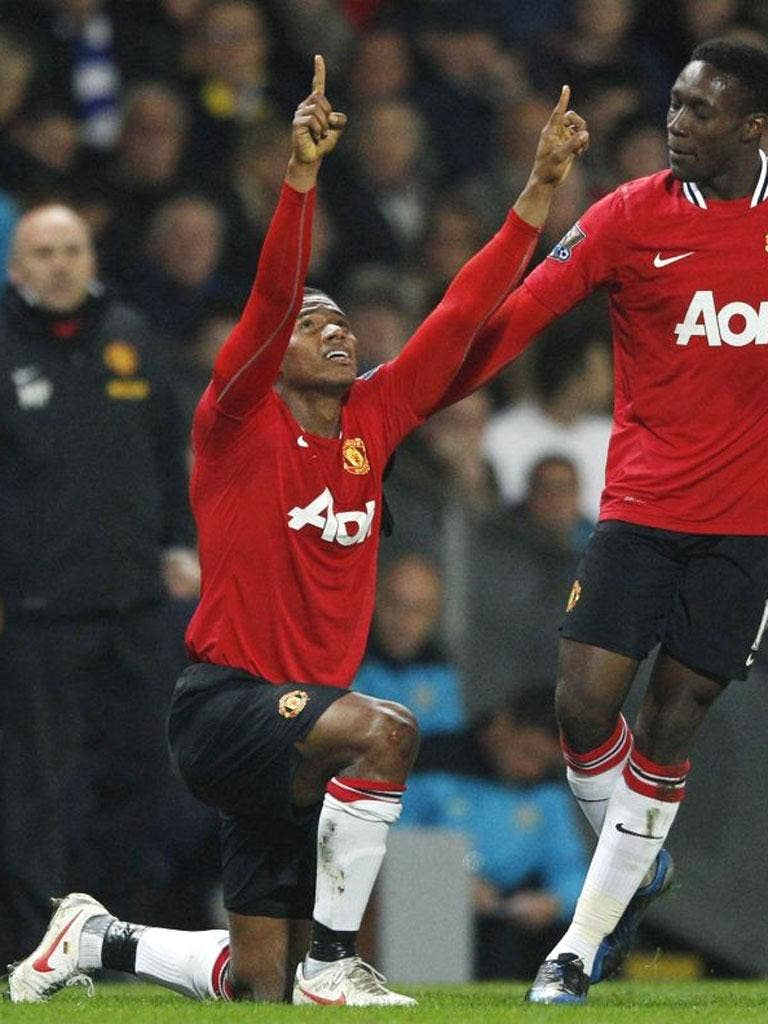 Antonio Valencia celebrates his goal against Blackburn Rovers with teammate Danny Welbeck at Ewood Park
