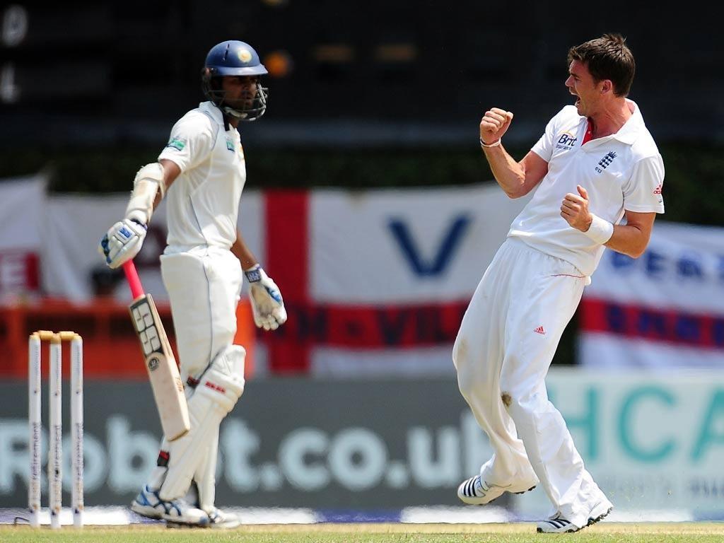 England cricketer James Anderson (R) celebrates his dismissal of Sri Lankan batsman Lahiru Thirimanne
