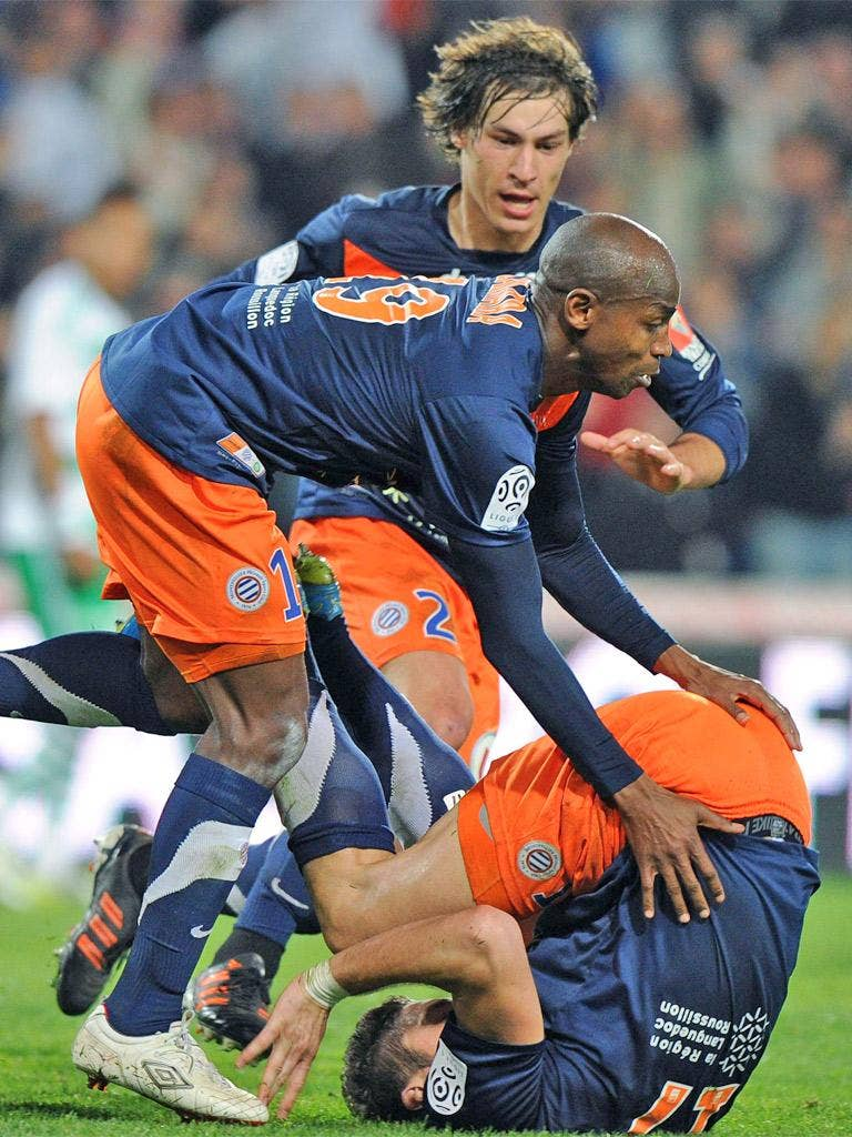 Montpellier's Olivier Giroud (bottom) takes a tumble after scoring against St Etienne