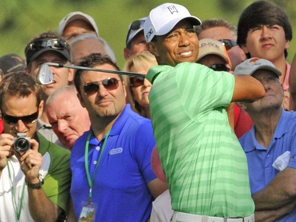 Tiger Woods gets used to his irons during a practice round before today's start of the 2012 Masters at Augusta