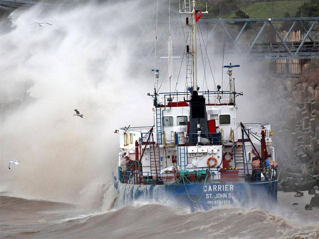 The grounded cargo ship MV Carrieris battered by waves after hitting rocks in Llanddulas, Wales