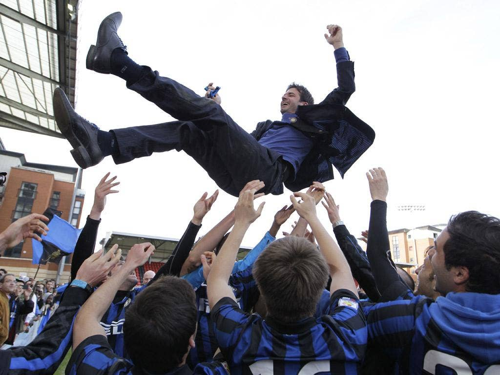 Internazionale's youth-team coach, Andrea Stramaccioni, is thrown into the air by his players after they won the NextGen Series final by beating Ajax at Leyton Orient's Brisbane Road. Stramaccioni is now first-team manager