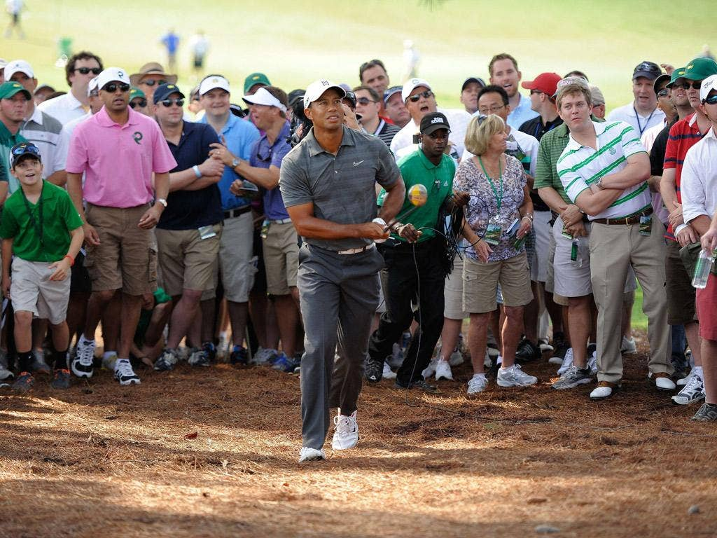Tiger Woods - and most of the Augusta crowd - keep a close eye on his shot