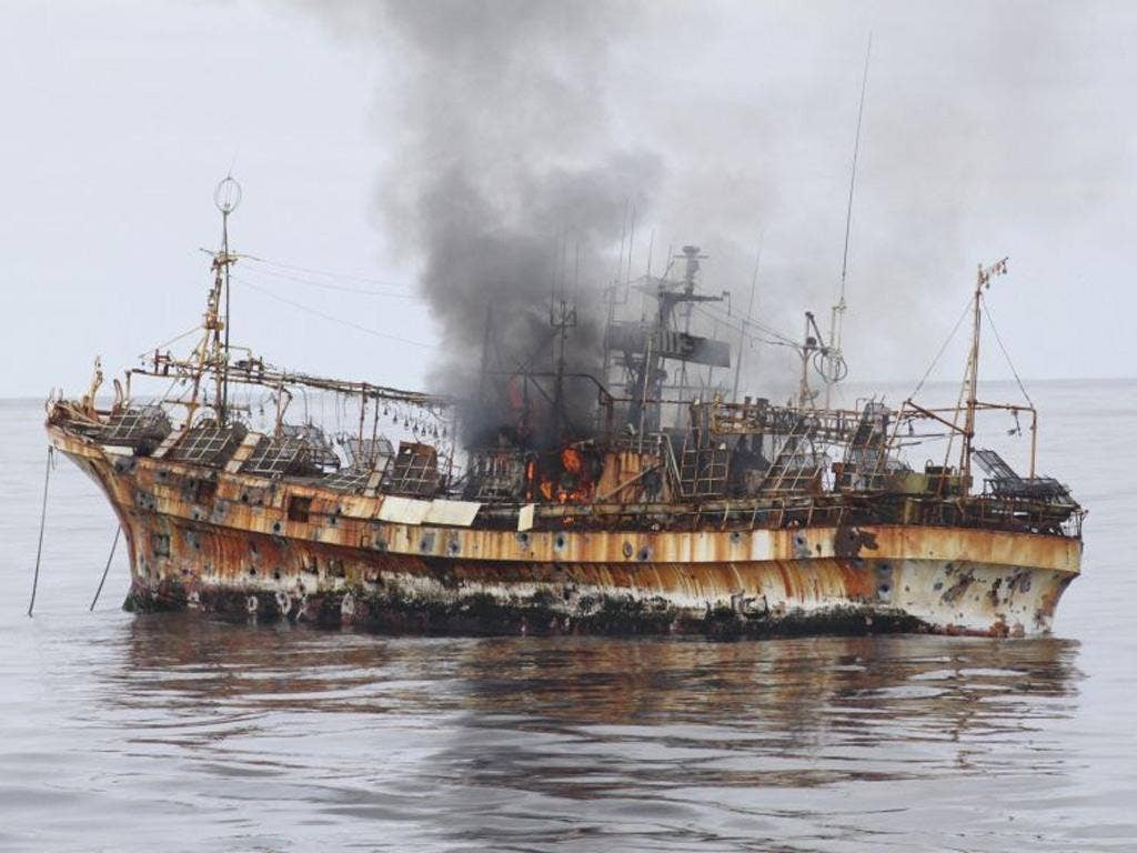 "Japanese fishing vessel, ""Ryou-Un Maru"", shows significant signs of damage after U.S. Coast Guard Cutter Anancapa fired explosive ammunition into it"