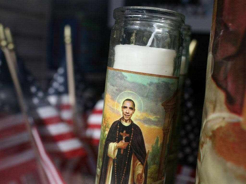 The President, given a saintly makeover on this votive candle, could be the first Oval Office resident in many years to finish a term without a major scandal