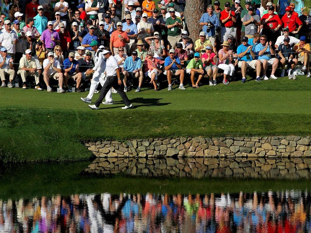 Phil Mickelson marches on to the 15th hole during his third round of 66 yesterday