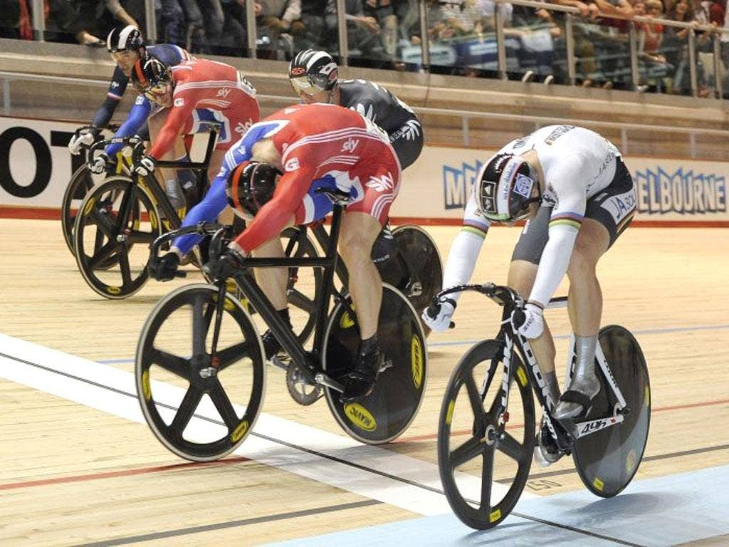 Chris Hoy crosses the line ahead of Germany's Max Levy to win the keirin