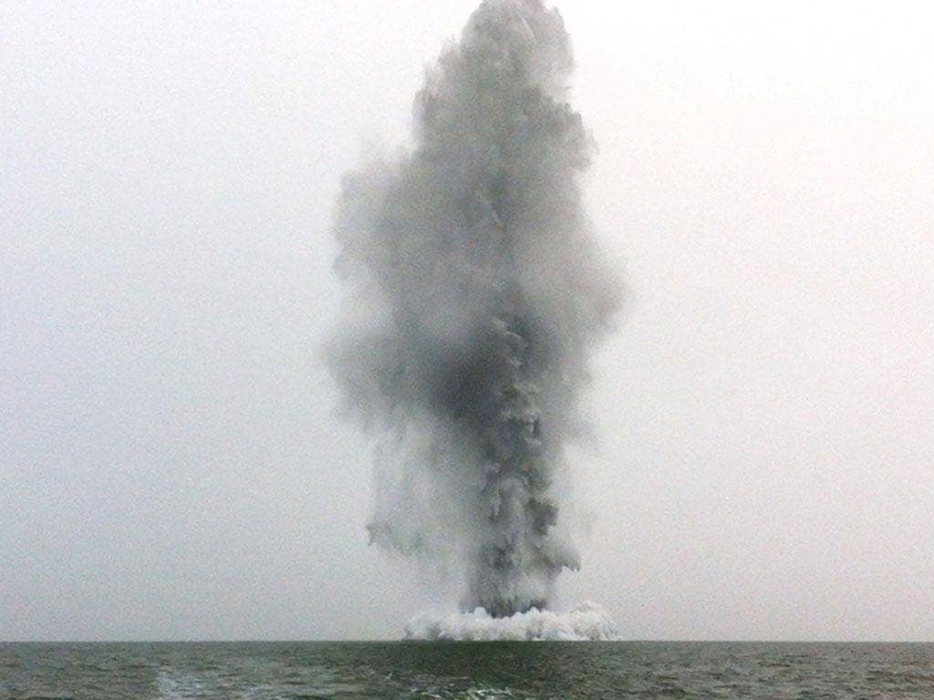 World War II German GC mine being destroyed by Royal Navy divers in the Thames Estuary at Sheerness off the Kent coast