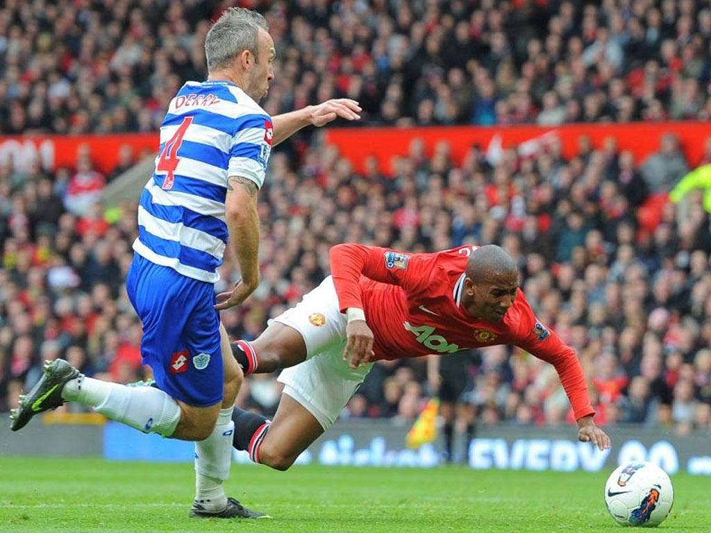 Ashley Young flies through the air to win a penalty after Shaun Derry's minimal contact