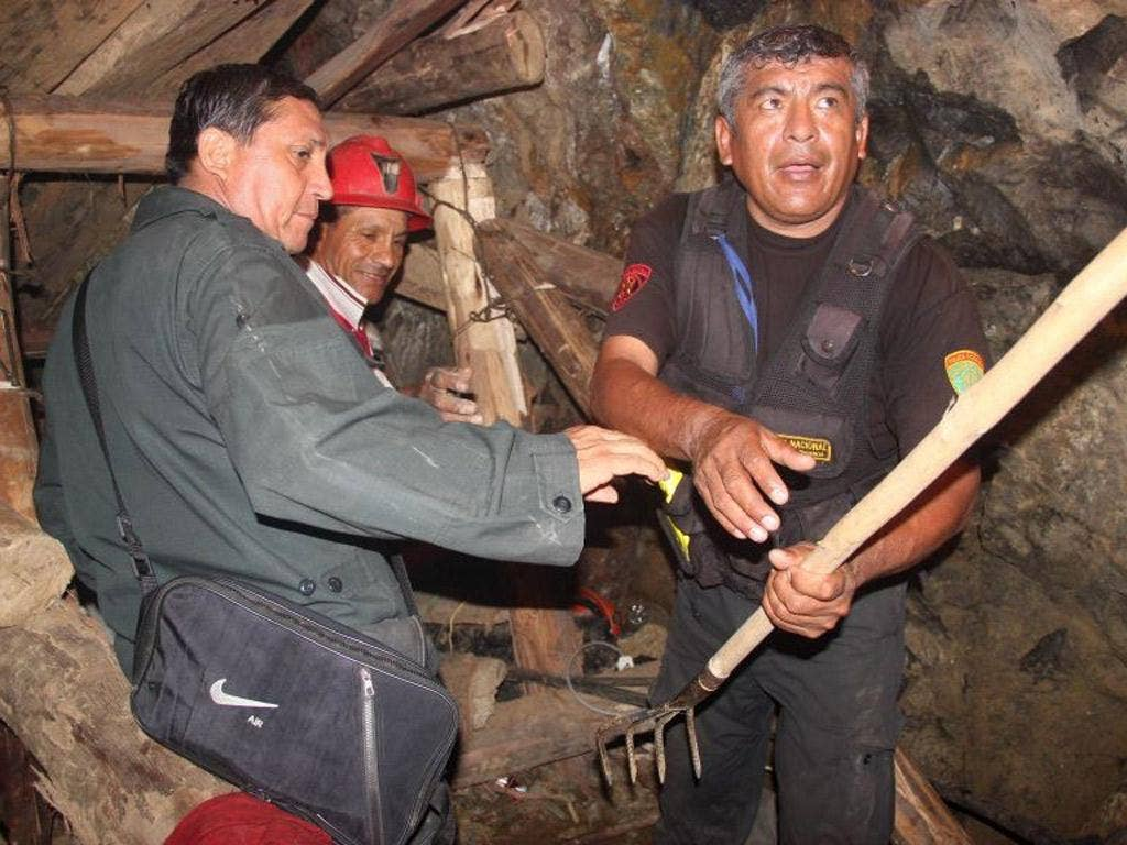 Rescue workers in the collapsed mine