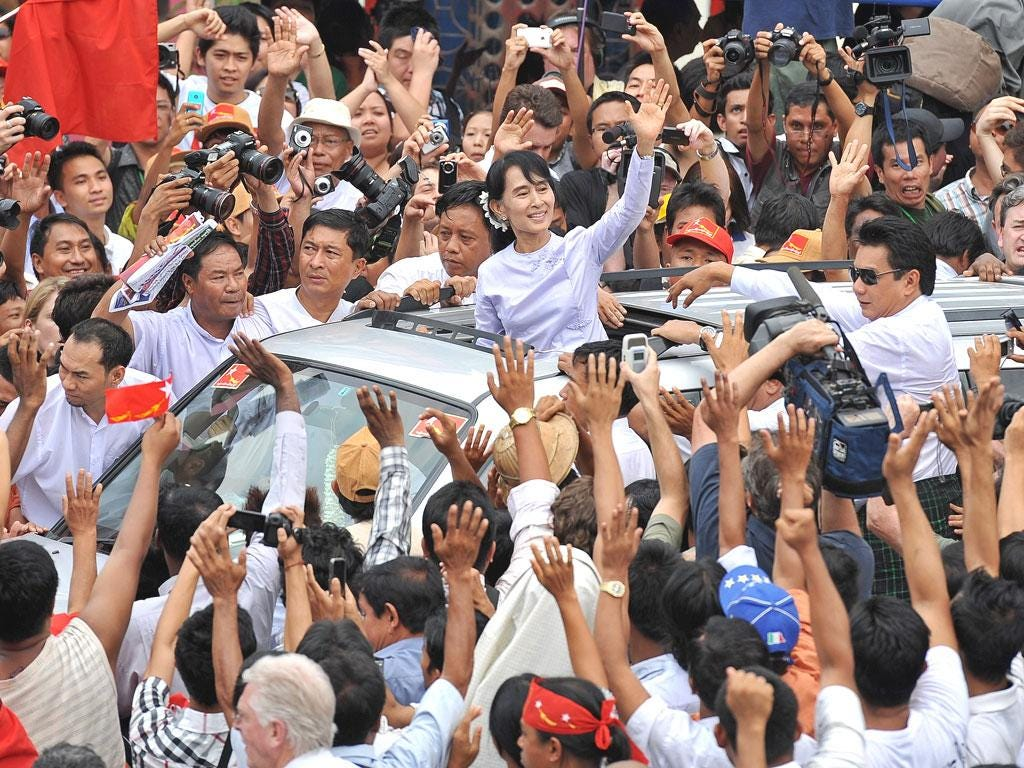 Aung San Suu Kyi surrounded by supporters after her election victory on 1 April, hailed as a 'historic result'