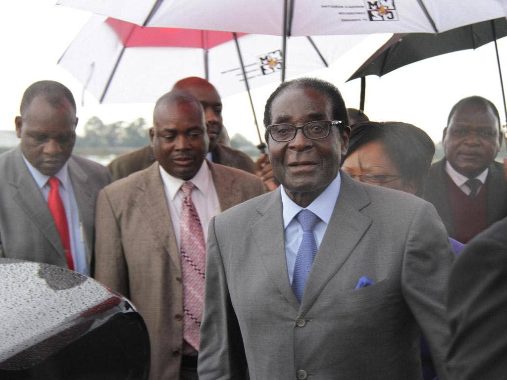Robert Mugabe flew back from Asia to Harare yesterday, seemingly in good health