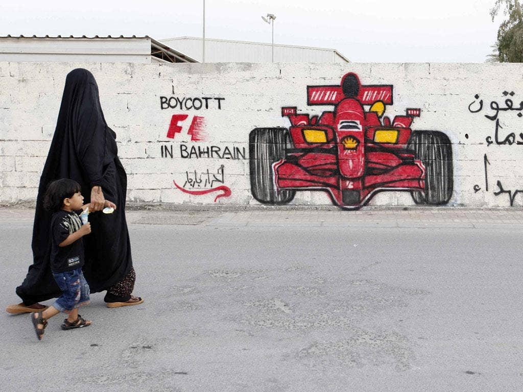 Graffiti shows the anger of protesters at Formula One's return to Bahrain after the cancellation of last year's Grand Prix