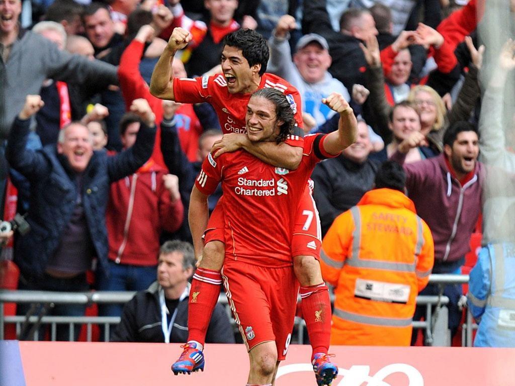 Andy Carroll celebrates with Luis Suarez