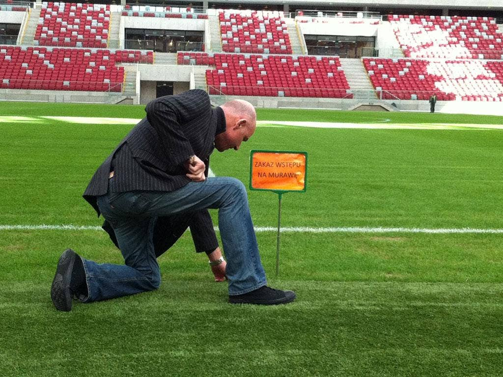 Turf accountant: Patrick Barclay tests the grass at Poland's National Stadium