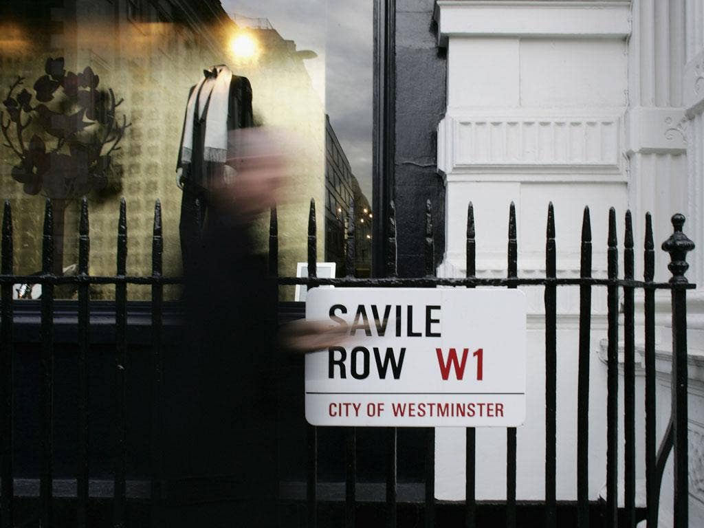 A dress from The Kooples costs £235 and the shoes £160, but they would lower the tone of Savile Row, according to the tailors who work there
