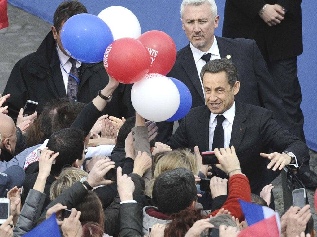 Sarkozy greets jubilant supporters before giving his speech in Paris