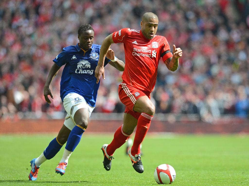 Glen Johnson shows Everton's Magaye Gueye a clean pair of heels during Liverpool's semi-final win