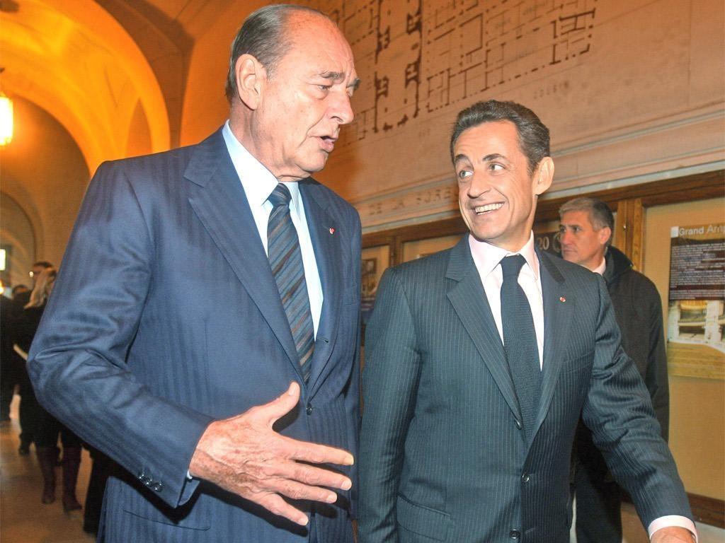 Former President Jacques Chirac and Nicolas Sarkozy