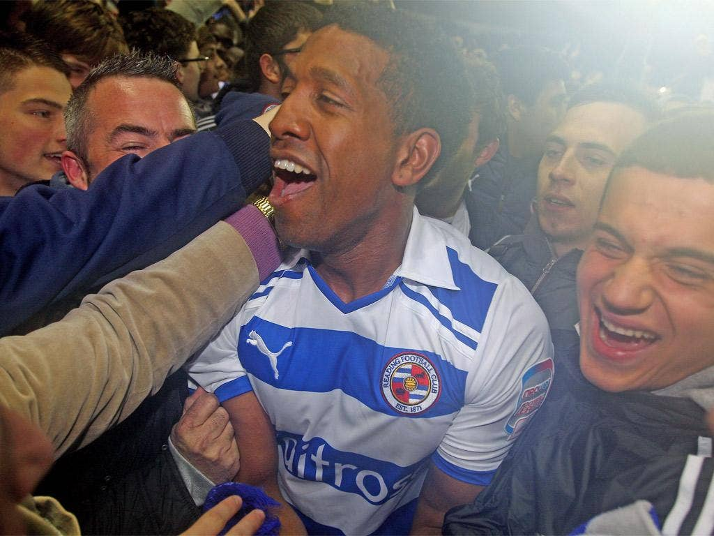 Mikele Leigertwood is mobbed by jubilant Reading fans