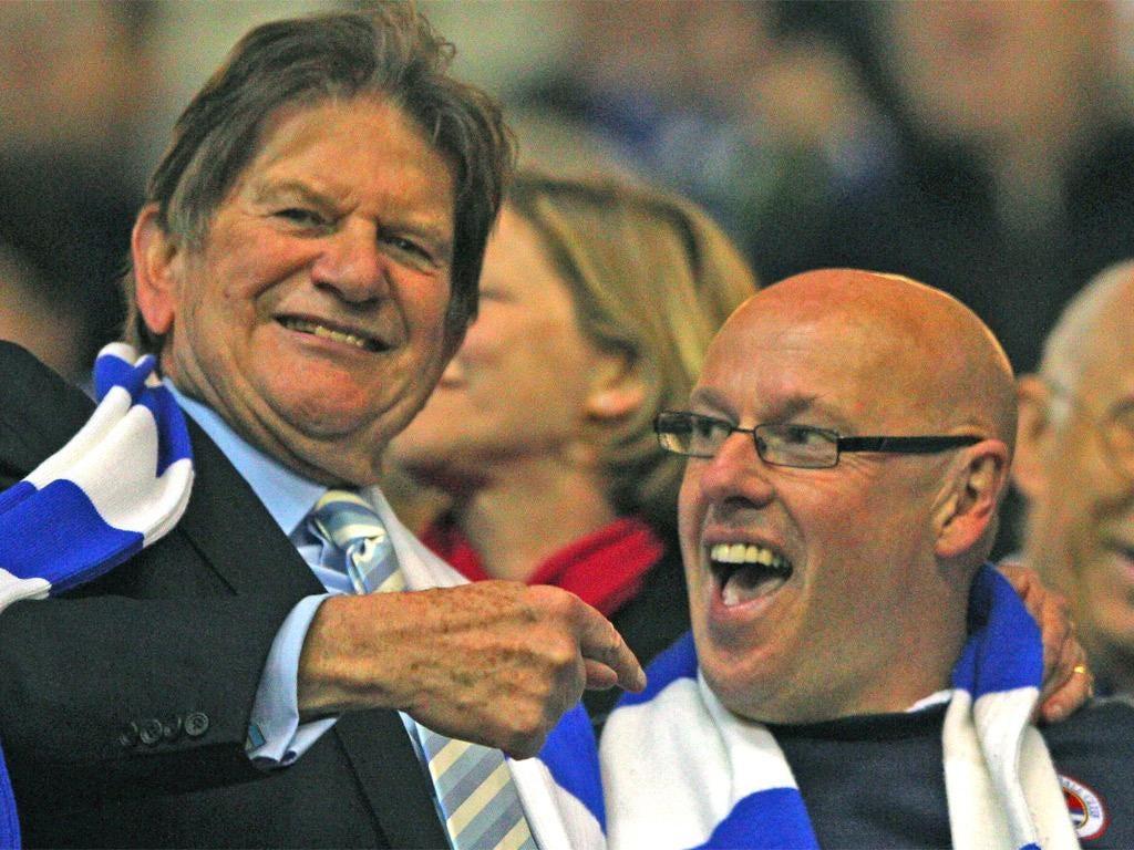Sir John Madejski (left) and Brian McDermott celebrate promotion