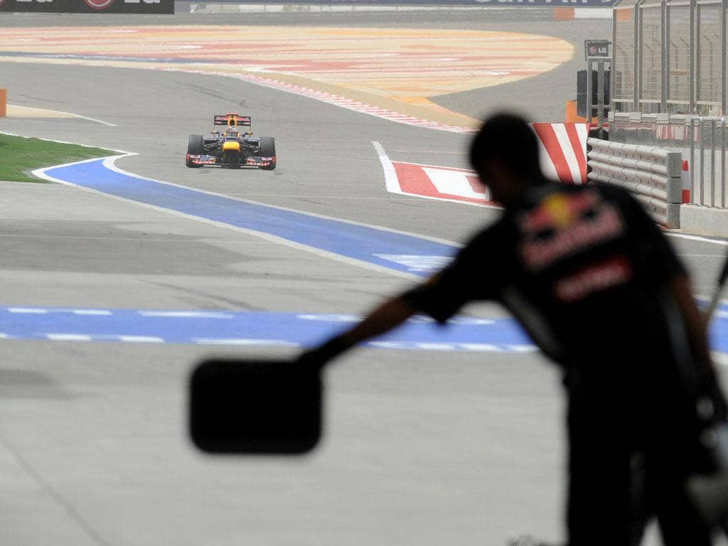 Red Bull Racing's German driver Sebastian Vettel arrives in the pits in Bahrain