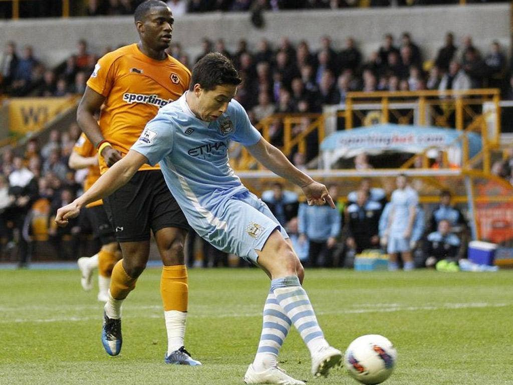 Manchester City's Samir Nasri scores against Wolves. The result confirmed relegation for Wolves manager Terry Connor and the club's supporters