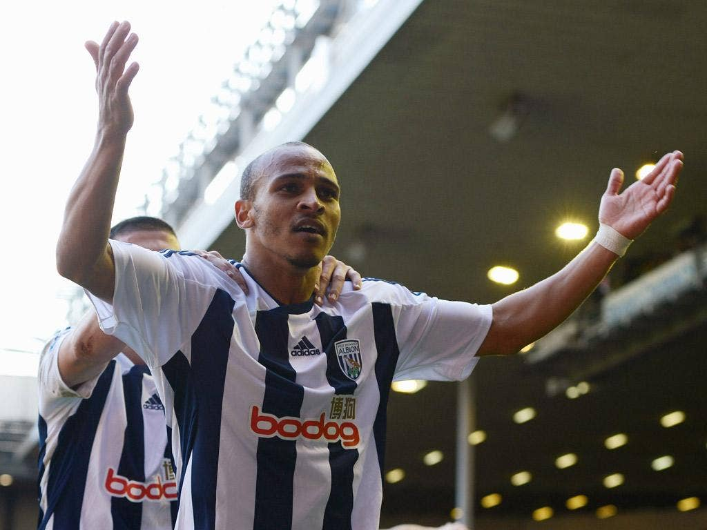 Peter Odemwingie enjoys his late winner at Anfield yesterday