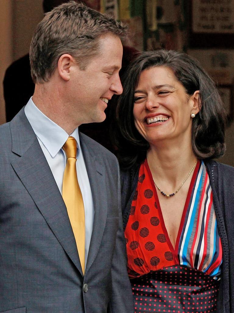 Britain's Liberal Democrat party leader Nick Clegg stands with his wife Miriam Gonzalez Durantez