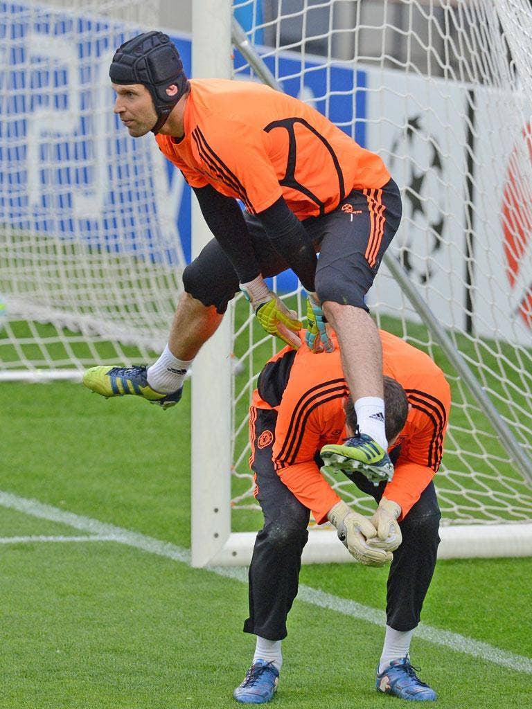 Petr Cech leapfrogs over team-mate Ross Turnbull