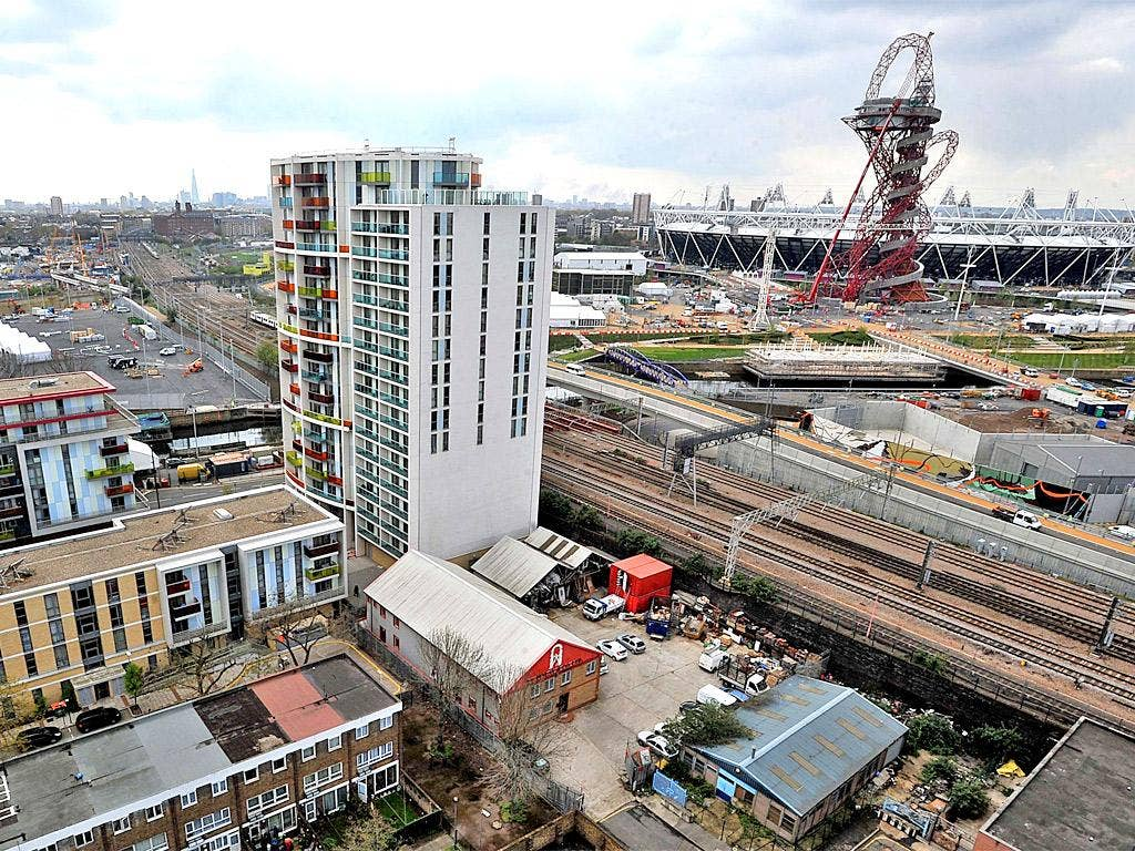 A view of housing and the Olympic Stadium in Newham, east London