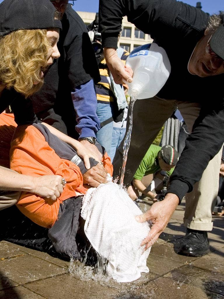 Protesters demonstrate the waterboarding technique on volunteer Maboud Ebrahim Zadeh in Washington