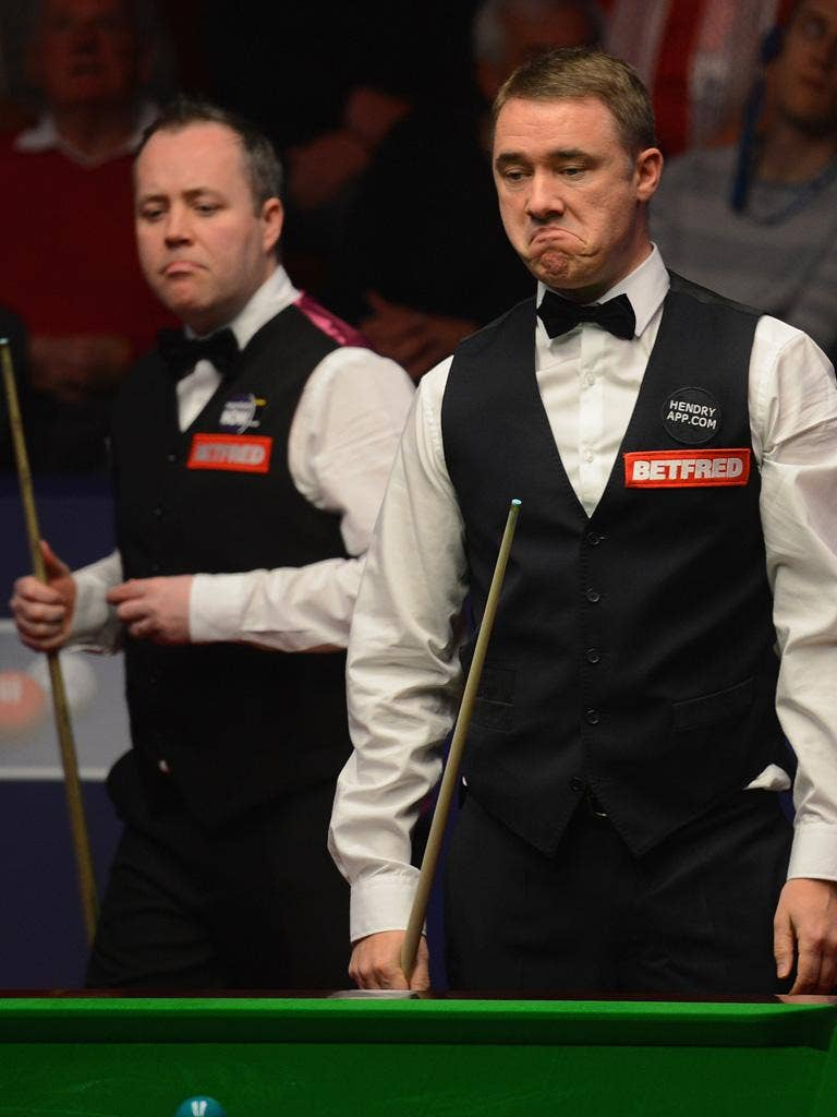Stephen Hendry (right) deliberates over a shot as John Higgins looks on