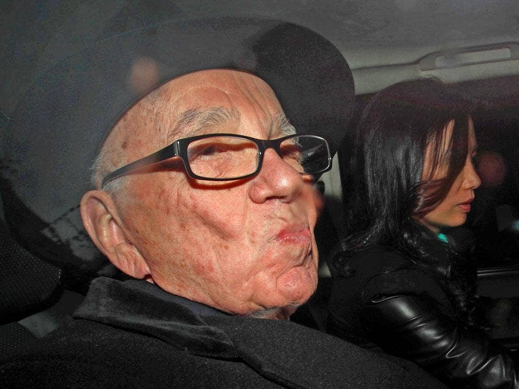Rupert Murdoch after giving evidence at the Leveson inquiry