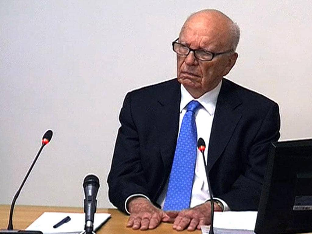 BURNING BRIDGES: Rupert Murdoch answers questions at the Leveson inquiry on Thursday