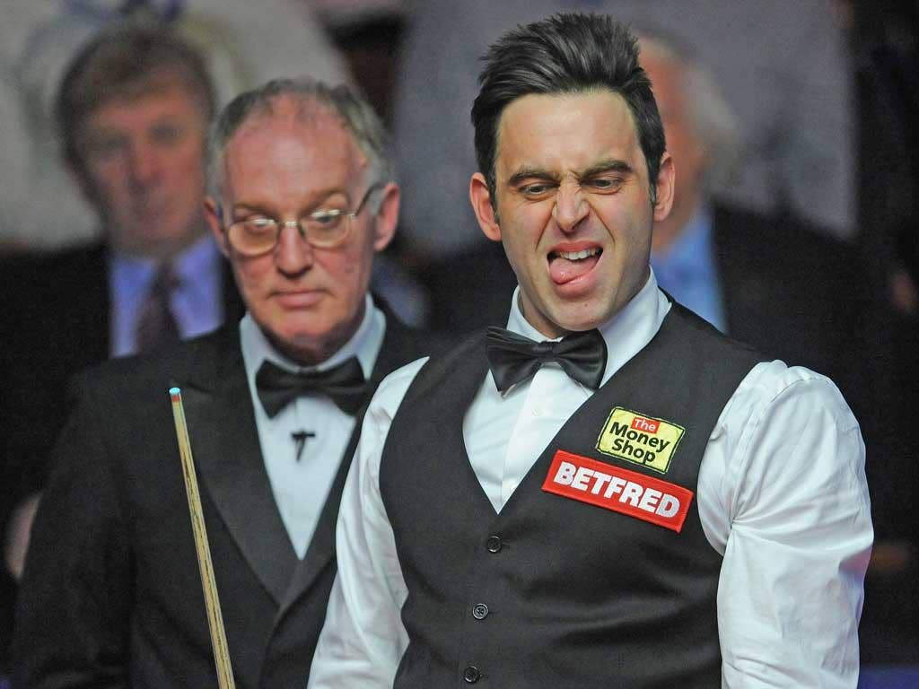 Ronnie O'Sullivan reacts to a shot during his match against Mark Williams at the Crucible
