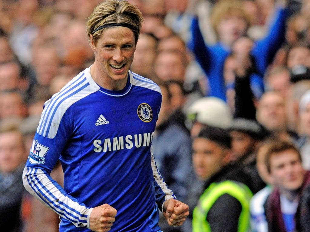 Fernando Torres celebrates his third goal in the 6-1 win over QPR