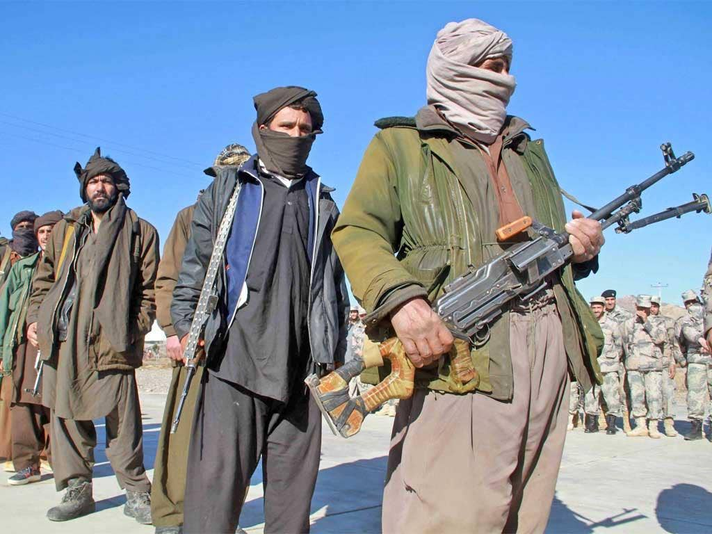 Taliban militants hand over their weapons after joining the Afghan government's reconciliation and reintegration program