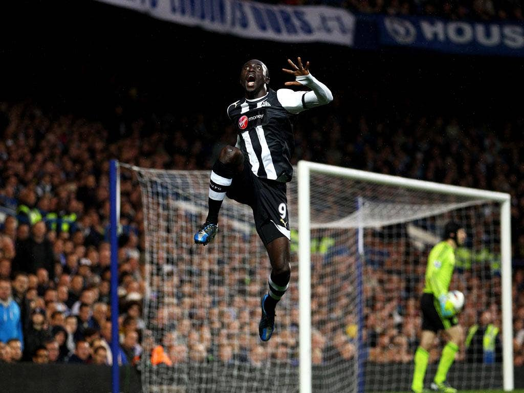 Papiss Cisse of Newcastle celebrates after scoring the opening goal during the Barclays Premier League match against Chelsea