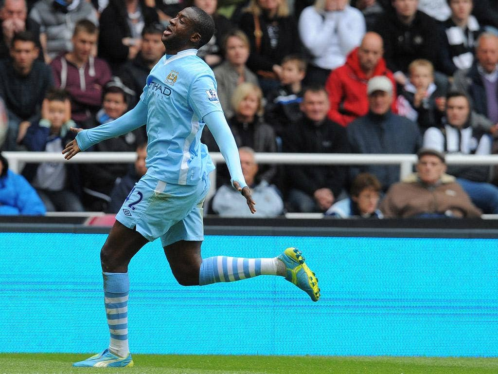 Yaya Toure scored a brace against Newcastle to keep Manchester City in contention for the Premier League title