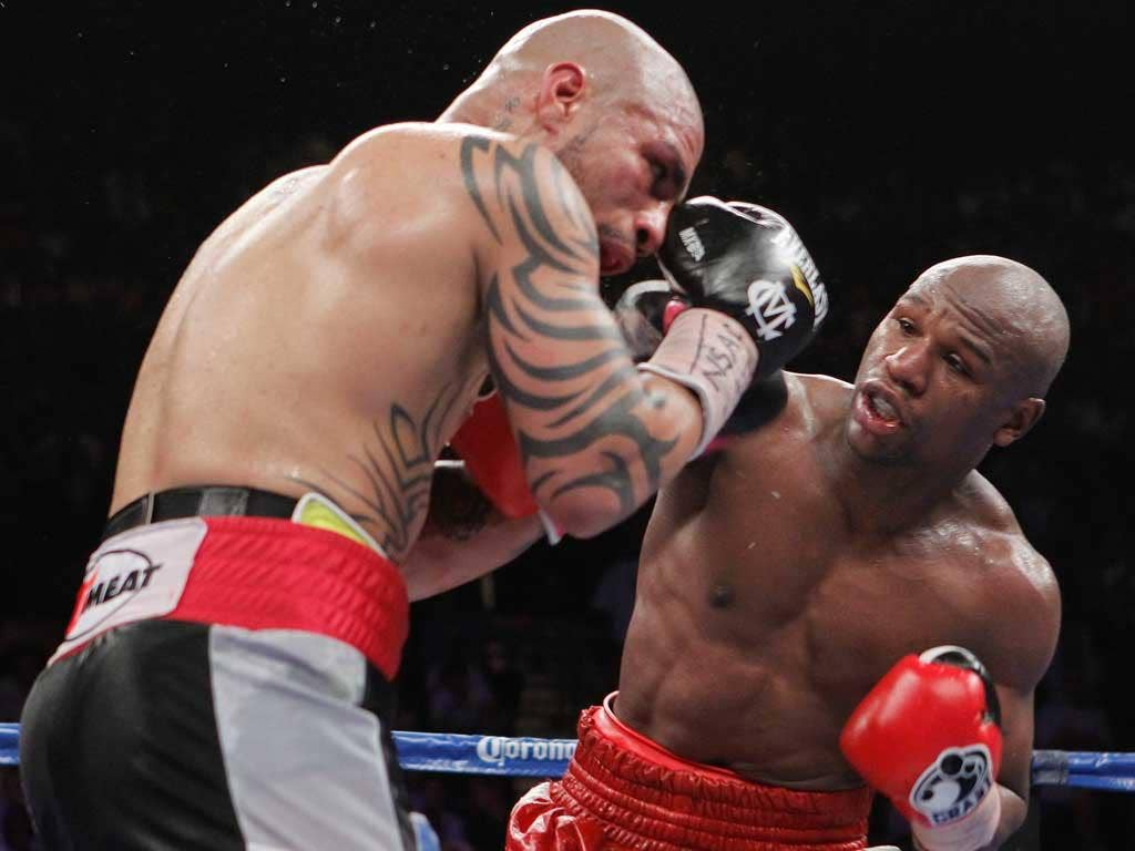 Floyd Mayweather connects with his right to hurt Miguel Cotto in his bloody but clear-cut victory in Las Vegas