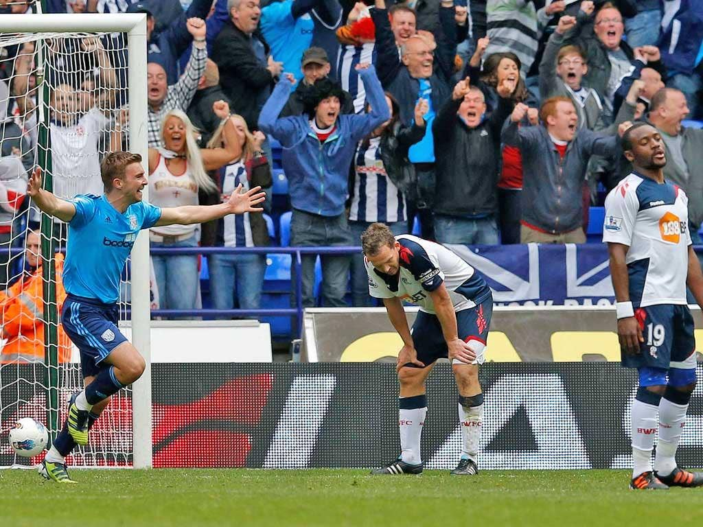 West Bromwich's James Morrison (left) celebrates the equaliser that leaves Bolton's players feeling down and out yesterday